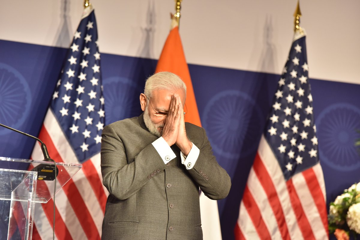 With hugs and praise, Modi and Trump strike rapport