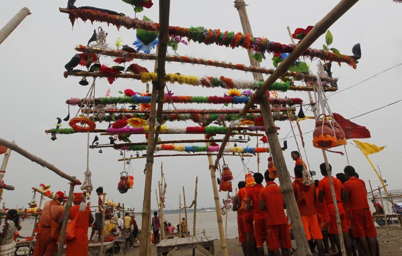 Kanwariyas (worshippers of lord Shiva) proceed towards Kashiviswanath Temple at Dashashwamedh Ghat in Allahabad