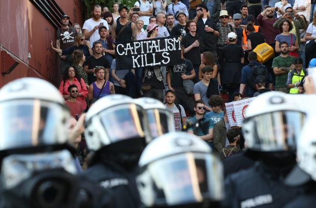 Trump argues with world leaders at G20 as violent protests engulf Hamburg