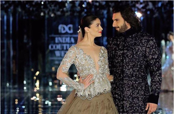 Ranveer Singh and actress Alia Bhatt walk on the ramp for the fashion designer Manish Malhotra collection show at the India Couture Week. They both are just looking fabulous together. Alia Bhatt wears an alluring gown from the Manish Malhotra collection while Ranveer looks hot in Sherwani.