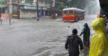 A bus struggles through a water-logged street after rains lashed Mumbai. All the means of transport are going down. Buses will perhaps support for sometime because cars and bikes can't move in most of the city.