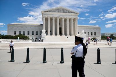 US court temporarily restores Trump's travel ban