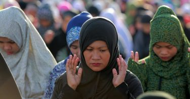 Muslims pray during the Eid al-Adha celebration in Taguig City, the Philippines.