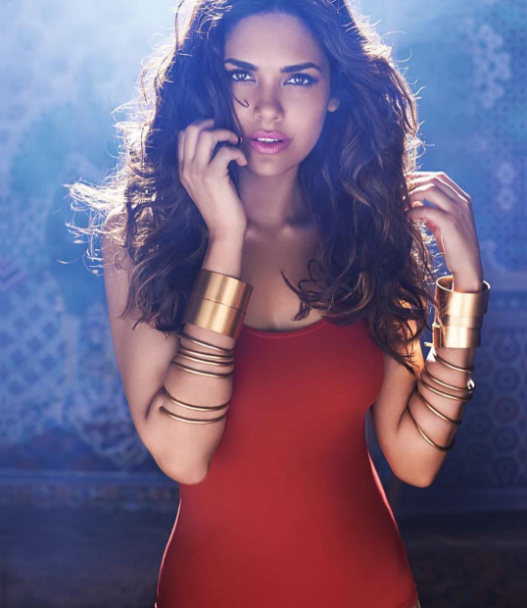 Esha Gupta has grabbed a lot of attention of the people by posting some of her bold pictures from some lingerie photoshoot. It seems that the actres has made a trend to keep her fans hooked with these tricks. In this picture she looks extremely stunning in this velvet red swimsuit  with her brown hairs drooping over her shoulders. Her pink glossy lipstick and cuff bangles also add to her beauty