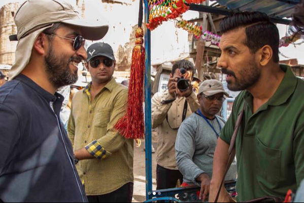 Bollywood actor John Abraham who is busy with his upcoming movie Parmanu is being clicked with the director of the movie Abhishek Sharma where he is seen preparing for a shot from the movie and looks very dedicated in the picture being clicked here.
