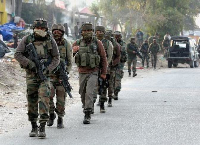 CRPF and terrorists exchange gunfire in a building after guard foils plan to enter camp