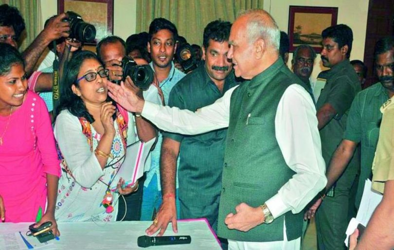 TN Governor Banwarilal Purohit patting journalist on the cheek without seeking consent