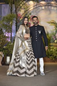 Sonam Kapoor and Anand Ahuja pose for the camera's