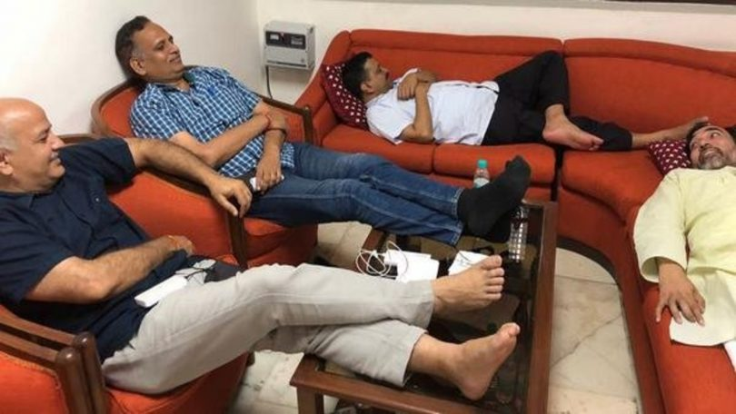 Delhi CM Kejriwal and three Ministers sitting in a Unique style in L-G's office